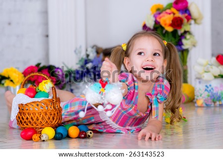 small child playing with Easter decorations
