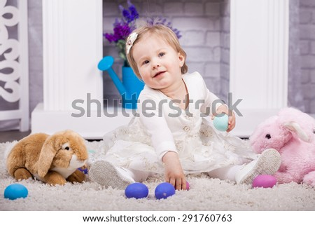 Small child playing with Easter holiday eggs