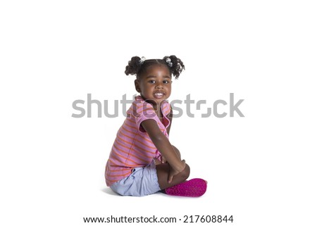 Small child sitting isolated on white