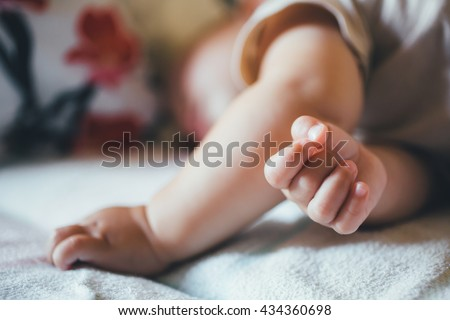 small child sleeps soundly during the day. Close-up - stock photo