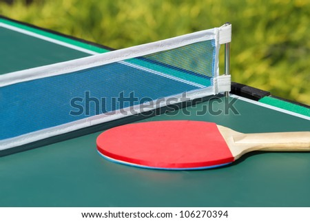 small child table tennis or ping pong in garden - stock photo