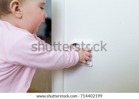 small child touches an electrical outlet at home safety of children - Pictures Of Small Children