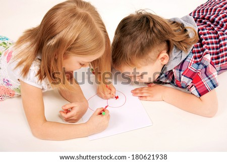 Small children, boy and girl drawing heart. Love and valentine's day concept. - stock photo