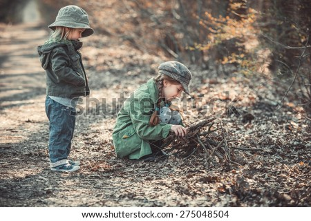 small children play in the woods, photo in vintage style - stock photo