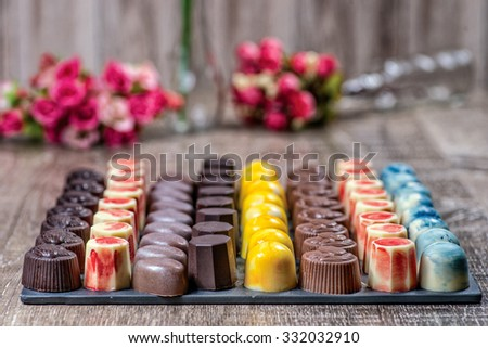 Small chocolate candy. A delicious mix of colorful chocolates. - stock photo