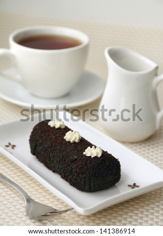 Small chocolate sweet cake on a plate