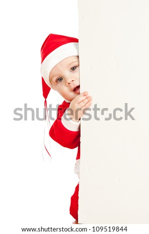 small Christmas Santa Claus child looking from behind the placard - stock photo