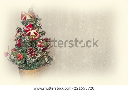 small christmas tree with snowfall background and white border - stock photo