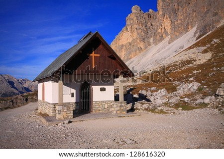 Small church at the base of the mountains, Dolomite Alps, Italy