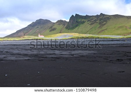 Small church in a meadow near the southern coast, Iceland - stock photo