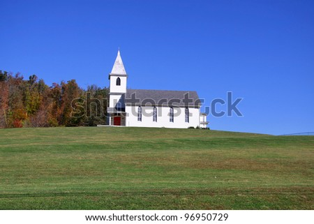 Small church on top of a green hill in West Virginia - stock photo