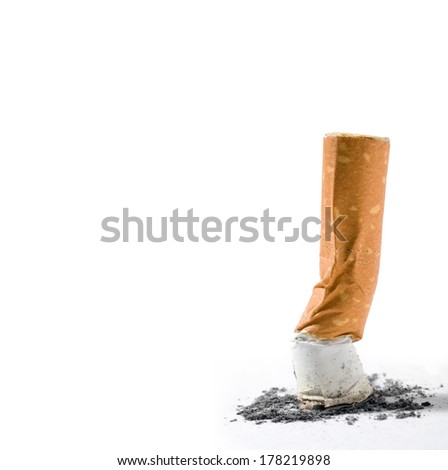 small cigarette end isolated over white background - stock photo