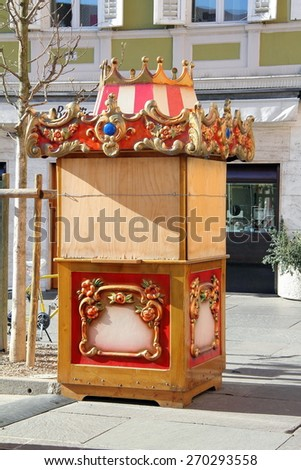 small circus booth, standing on the street