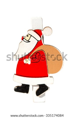 Small clothespin with a Santa Claus, Christmas motifs, close-up isolated on white background - stock photo