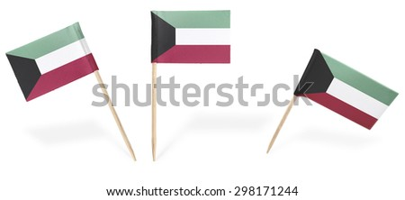 Small cocktail flags of Kuwait in different positions isolated on white.(series) . Also easy to use as a design element :)  - stock photo