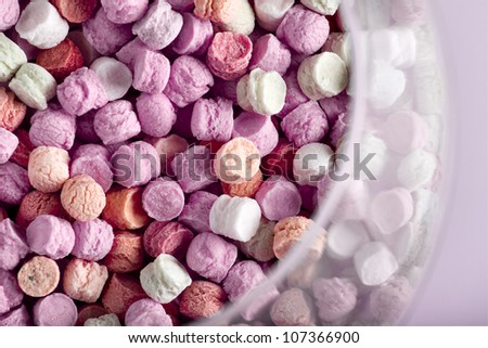 small colored candies in a glass jar - stock photo