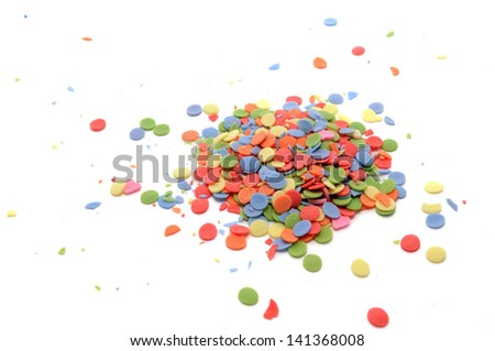 Small colored sugar sprinkles of various types isolated on white background. Used as a decoration or to add texture to cupcakes, cookies, cakes, doughnuts, ice cream, frozen yogurt and puddings. - stock photo