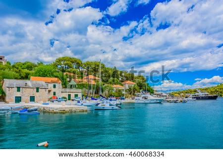 Small colorful mediterranean town Rogac on Island of Solta, touristic destination on Adriatic sea, Croatia. / Rogac promenade seascape. / Selective focus. - stock photo