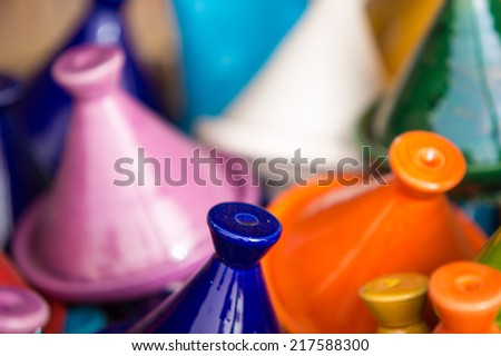 Small coloured Tajines, plates and pots made of clay on the market of Tiznit in Morocco - stock photo