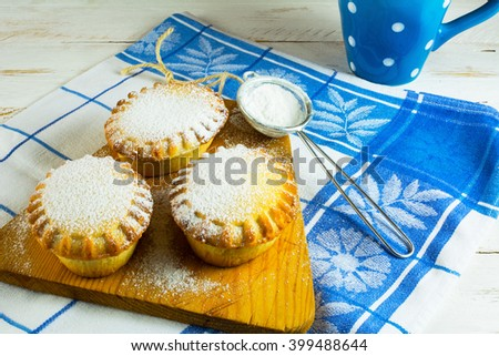 Small confiture pie and custer sugar in sieve for a baking. Jam pie. Small pie. Pie. Sweet pastry. Sweet dessert  - stock photo