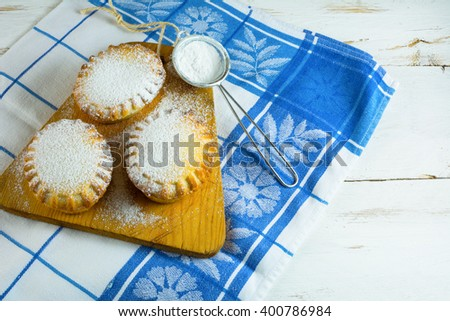 Small confiture pie on the cutting board. Jam pie. Small pie. Pie. Sweet pastry. Sweet dessert - stock photo