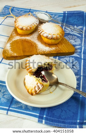 Small confiture pie on the white plate. Sweet dessert. Sweet pastry. Small pie. Pie. Jam pie - stock photo