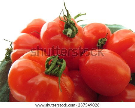 Small container of bright red strawberry tomatoes - stock photo