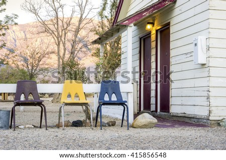 Small cottage house with 3 chairs in front of it in the Death Valley area. - stock photo