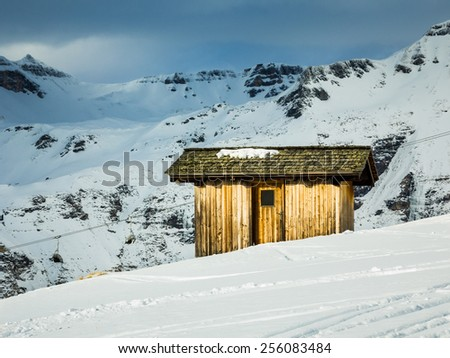 Small cottage in the mountains - stock photo