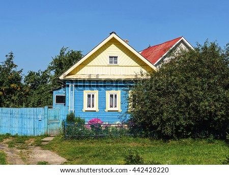 Small country wooden house, summer sunny day