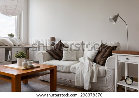 Small cozy living room in white flat - stock photo