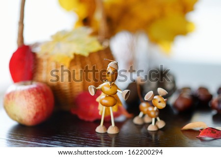 Small creature made of chestnuts and acorns - stock photo