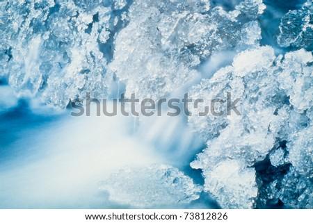 Small creek freezing up at -40 below. - stock photo