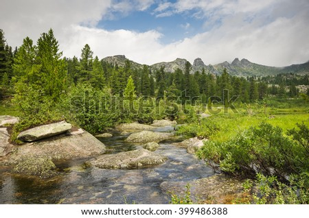 Small crystal clear mountain river in the mountains of Siberia, natural Park Ergaki - stock photo