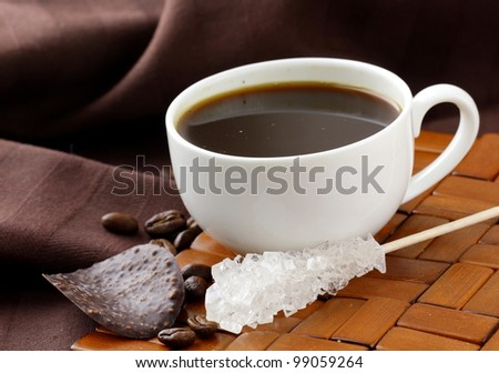 small cup of coffee espresso on a brown background