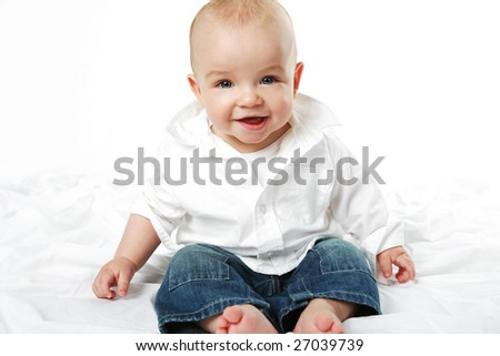 Small cute baby boy posing on white background.
