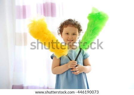 Small cute girl cleaning room