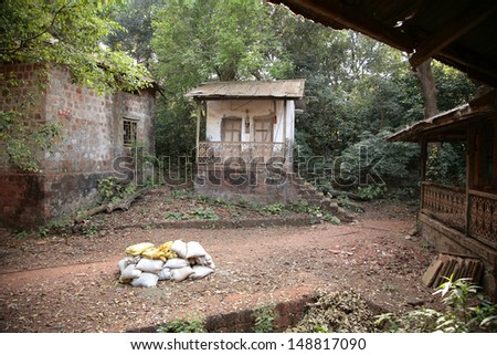 Small damaged houses in India - stock photo