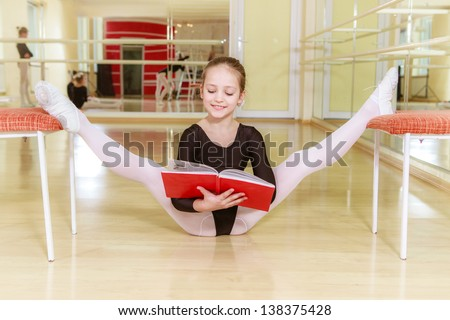 small dancer on a chair with dancing school