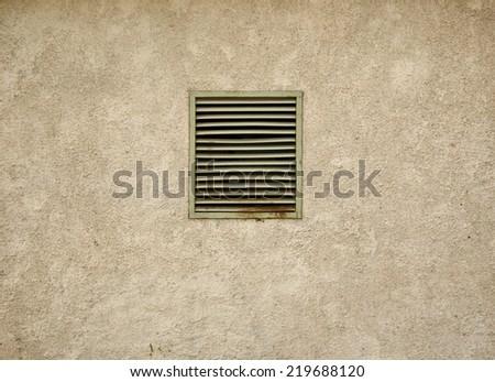 Small dark basement window with rusted steel lattice - stock photo