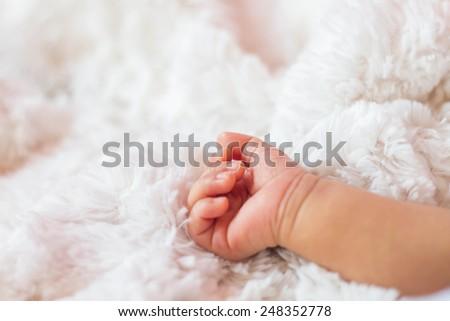Small delicate little hand of newborn - stock photo