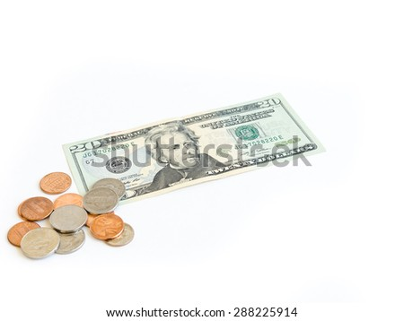 Small denomination US dollars banknote and coins on white background. Concept for tipping, cash reward concept. Currency, business and finance concept.Copy space. - stock photo