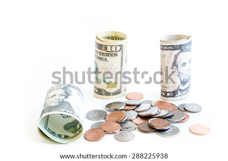 Small denomination US dollars banknote and coins on white background. Concept for tipping, cash reward concept. Currency, business and finance concept.