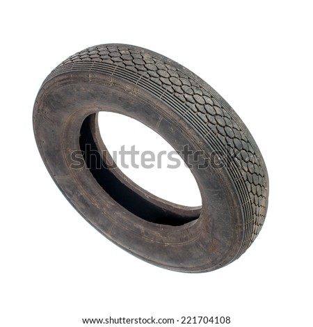 Small dirty old tire isolated on white - stock photo