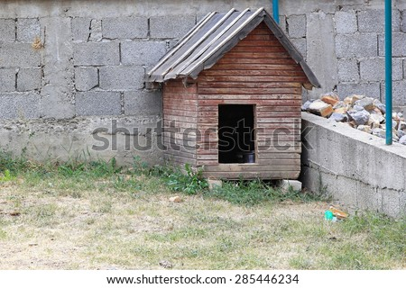 Small dog house shed in garden - stock photo