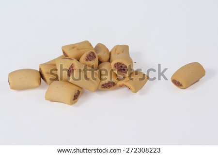 Small dog treats isolated on white.