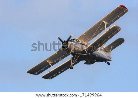 Small double wing airplane - stock photo