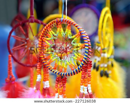 Small dream catchers under sun - stock photo