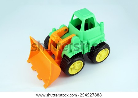 Small dredge toy. Kids dredge toy. - stock photo