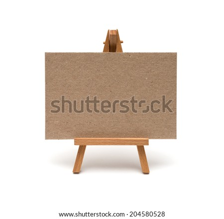 Small easel with sheet of paper isolated on white